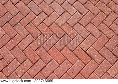 Abstract Background From Paving Red Tiles, Bricks. Top View Of The Pavement Pattern. Concept For Con