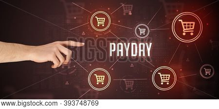 Close-Up of cropped hand pointing at PAYDAY inscription, online shopping concept