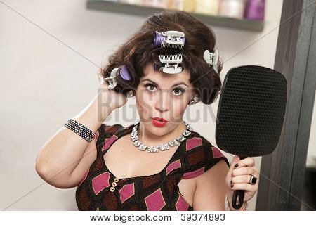 Woman In Curlers Holding Mirror