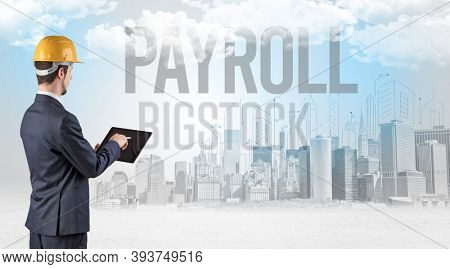 Young businessman with hard hat and PAYROLL inscription, new business opportunity concept