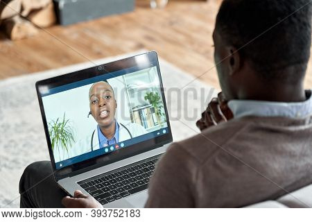 Male Black Patient On Conference Video Call With Female African Doctor. Virtual Therapist Consulting