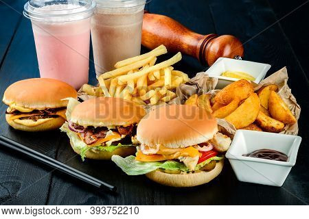 Fast Food Collection On Wooden Table Background. Unhealthy Food Concept, Fast Food Set With Burgers
