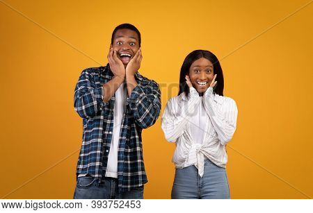 Happy, Funny And Surprise Are Natural Emotions. Amazed African American Young Man And Woman With Ope
