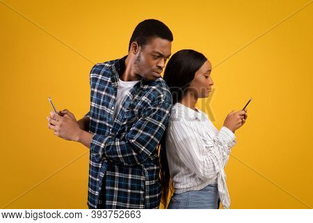 Jealous Man Checks Female Phone. Strict Millennial African American Guy Look, Wife In Casual, Textin
