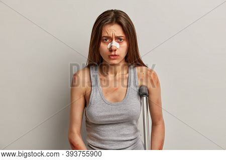 People, Health Problems And Insurance Concept. Dissatisfied Woman Has Inline Skating Accident, Has R