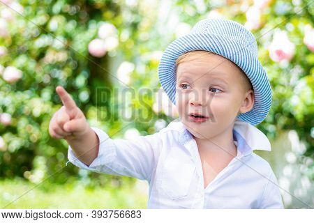 Funny Child Face. Happy Child In Summer In Nature. Portrait Of Happy Smiling Child Boy On Nature Bac