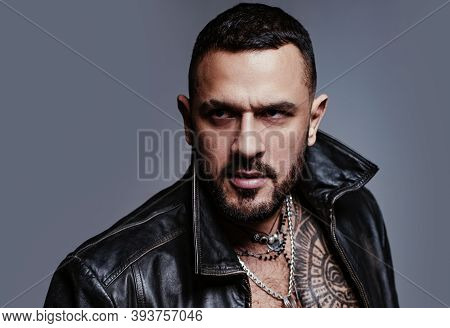 In His Brutal Style. Brutal Hispanic Man. Bearded Latino Man With Brutal Tattoo On Muscular Chest. B
