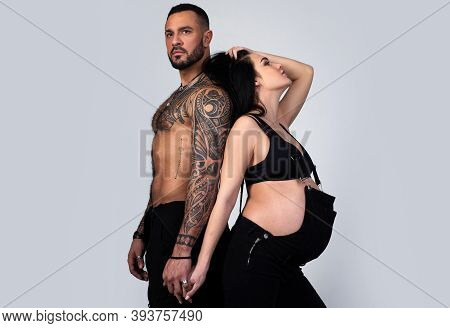Planned Parenthood. Well-groomed Bodies Of Future Parents. Pregnancy, Maternity, Preparation, And Ex