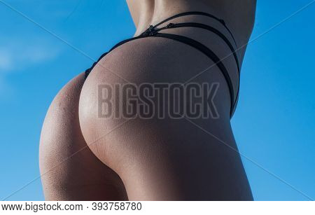 Female Ass Or Womans Buttocks In Lingerie. Woman Ass In Underwear With Sexy Ass Posing. Bikini Model