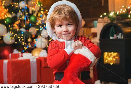 Oh Happy Day. Child Cheerful Face Got Gift In Christmas Sock. Contents Of Christmas Stocking. Joy An