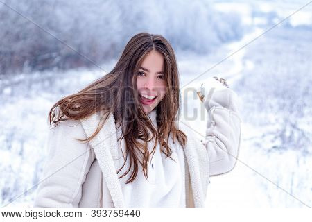 Happy Winter. Playing With Snow And Having Fun In Winter Park. Activity Smiling Girl In Winter Trave