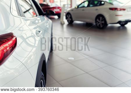 New White Cars At Dealer Showroom With Blurred Background