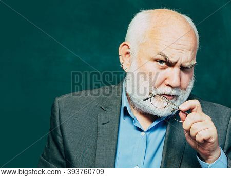 Chalkboard Copy Space. Old Bearded Mature Teacher. Teacher Is Skilled Leader. Teachers Challenges An