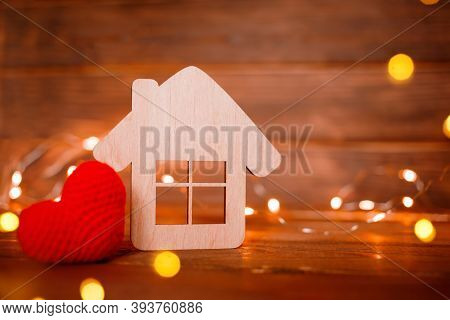 Wooden House With Little Heart With Light On Wooden Background Horizontal. Copy Space