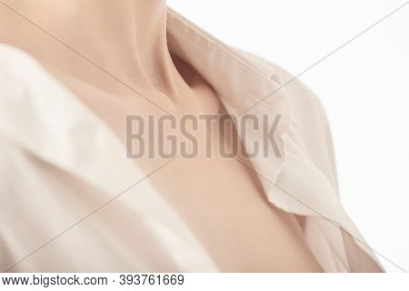 Beautiful Female Body With Clavicles In Shirt On White Background