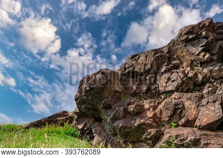 Natural Landscape Background, Bright Blue Sky With White Cumulus Cloud. Rock On Top Of The Mountain