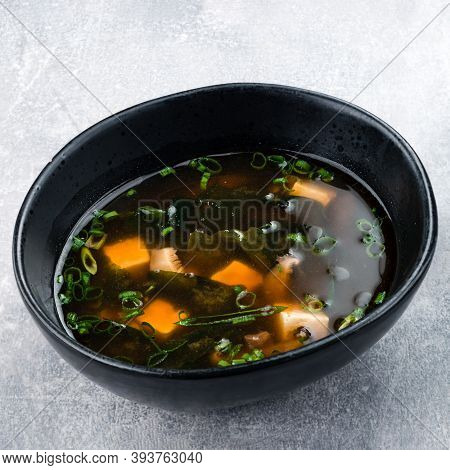 Japanese Miso Soup With Tofu On The Table. Top View Of Miso Soup With Shiitake Mushrooms And Seaweed