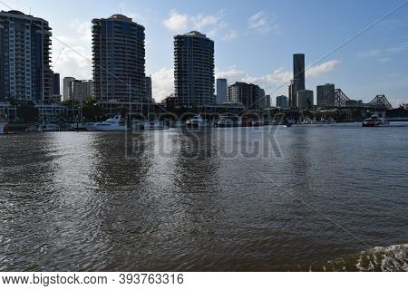 Modern Skyscrapers, Buildings And View On Big Bridge Near The Brisbane River