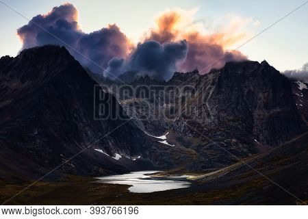 Beautiful Aerial View Of Dramatic Mountains And Scenic Alpine Lake During Fall In Canadian Nature. D