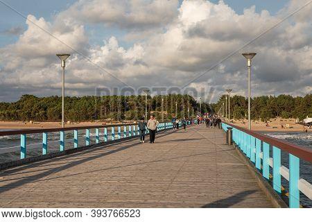 Palanga, Lithuania - July 11, 2020: People Stroll On The Palanga Pier (palanga Bridge) At The Baltic