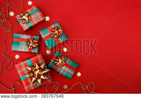 Christmas Composition Greeting Card. Gifts On A Red Background. Top View, Flat Lay.