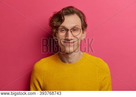 Headshot Of Funny Postive Hipster Guy Smiles Happily, Has Sincere Optimistic Gaze At Camera, Wears R