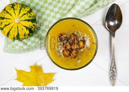 Creamy Squash Soup With Beans, Top View. Spoon, Kitchen Towel And Little Pumpkins.