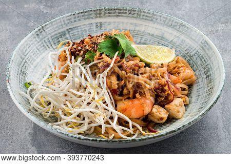 Seafood Pad Thai Dish Of Stir Fried Rice Noodles. Pad Thai With Shrimp