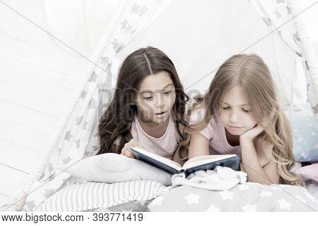 Girls Best Friends Read Fairy Tale Before Sleep. Best Books For Kids. Children Read Book In Bed. Rea