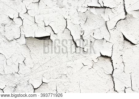 A Cracked White Thing On The Wall.the Texture Is Detached Under The Influence Of The Weather Paint A