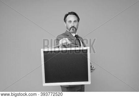 Go Up To The Blackboard. School Teacher Hold Blackboard Grey Background. Blank Blackboard For Advert