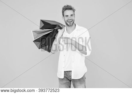 Big Discount. Happy Man Holding Purchases In Paper Bags. If I Want I Will Get. Bachelors Day. Consum