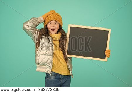 Smiling Girl Wear Winter Outfit Show Blank Chalkboard Copy Space. Informing Kids Community. Kid With