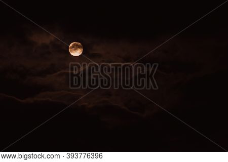Super Moon. An Attractive Photo Of The Night Sky Background With A Cloudy And Bright Full Moon. Nigh