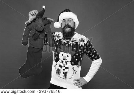 Each Surprise Is Just That. Surprised Hipster Hold Reindeer Toy. Bearded Man Prepare Surprise Gift.
