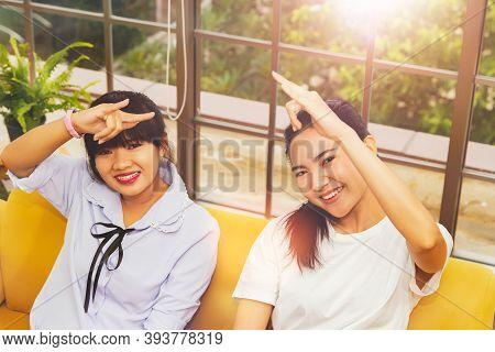 Concept Communication Using Sign Language : The Fun, Companionship Of Two Asian Women Using Sign Lan