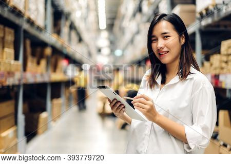 Portrait Of Asian Manager Worker Woman Standing And Order Details On Tablet Computer For Checking Go