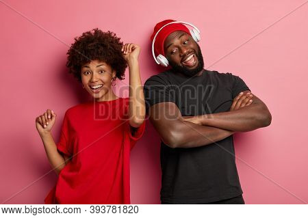 Adorable Curly Girl Smiles And Dances To Music Together With Male Fellow, Enjoy Spending Time Togeth