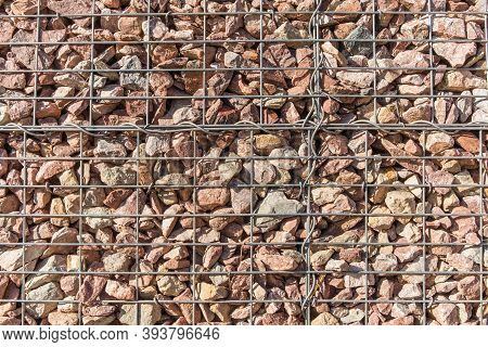 Retaining Wall Gabion Baskets, Gabion Wall Caged Stones Textured Background. Gabion Wall Caged Stone