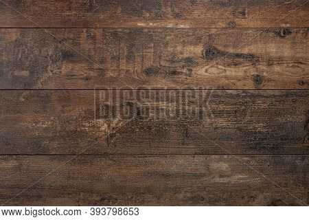Wooden Background. Texture With An Old, Rustic, Brown Planks. Old Vintage Dark Brown Wooden Table Te