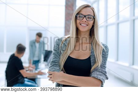 Portrait of young business woman in the office.