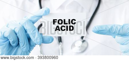 Doctor Holding A Card With Text Folic Acid, Medical Concept