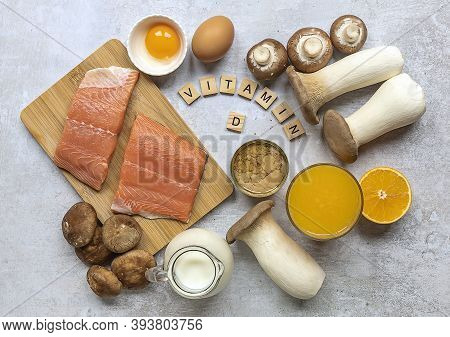 Flat Lay Composition With Products Rich In Vitamin D. Canned Tuna, Mushrooms, Salmon, Eggs, Milk, An