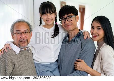 Group Portrait of Happy multigenerational asian family standing in living room with smile in new apartment. Muti genration family happiness concept.