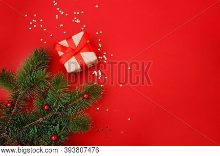 Christmas Composition Greeting Card. Gifts From Craft Paper On A Red Background With A Gold Star Con