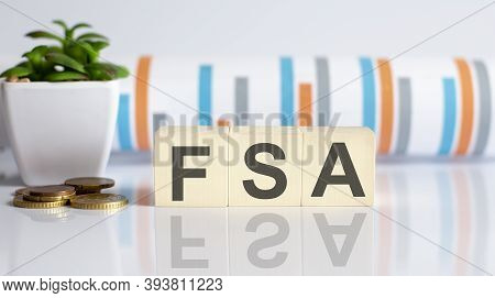 Flexible Spending Account Fsa Written On A Wooden Cubes With Charts