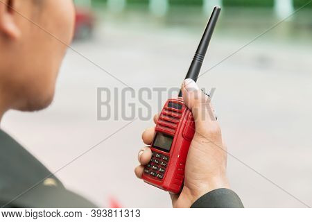 Security Guard Uses Radio Communication For Facilitate Traffic. Traffic Officers Use Walkie Talkie T