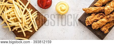 Fish And Chips. Deep Fried Fish Filet And With French Fries On White Banner Background With Sauces.