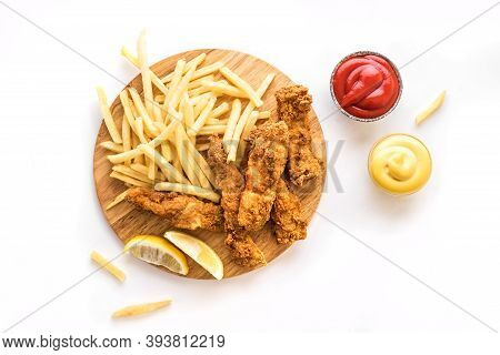 Fish And Chips. Deep Fried Fish Filet And With French Fries Isolated On White Background With Sauces