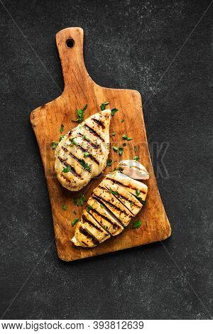 Grilled Chicken Breast, Fillet, Steak On Wooden Board, Top View, Copy Space. Healthy Keto, Ketogenic